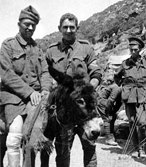 Old black and white photo with wounded soldier on a donkey and private Simpson to his right