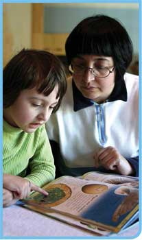 A woman and child reading together